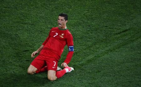 KHARKOV, UKRAINE - JUNE 17:  Cristiano Ronaldo of Portugal celebrates scoring his team's second goal during the UEFA EURO 2012 group B match between Portugal and Netherlands at Metalist Stadium on June 17, 2012 in Kharkov, Ukraine.  (Photo by Lars Baron/Getty Images)