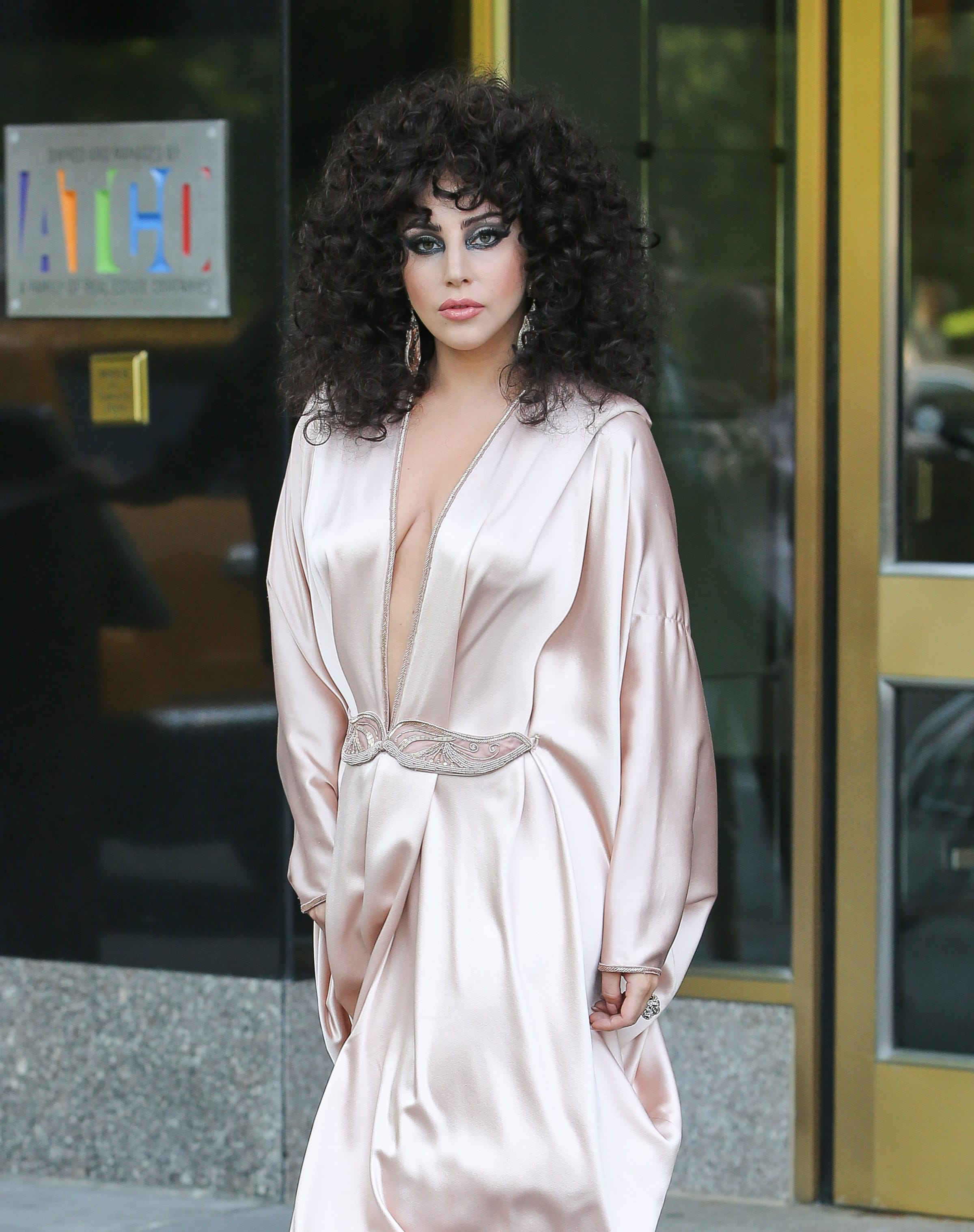 Lady Gaga spotted wearing a long pink dress while leaving her apartment building in New York City