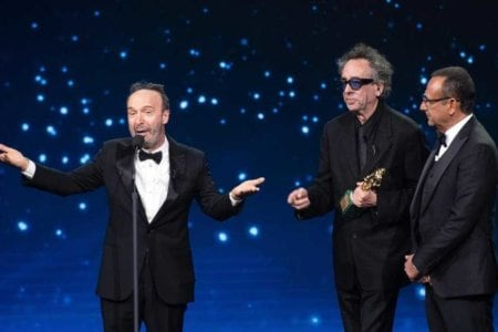US film director Tim Burton (C) with Italian film director and actor Roberto Benigni and Italian presenter Carlo Conti (R) on stage in the occasion of the 64th edition of the ?David di Donatello Awards? in Rome, Italy, 27 March 2019. The David di Donatello award is a film prize presented annually to honor the best of Italian and foreign motion picture productions. ANSA/CLAUDIO PERI