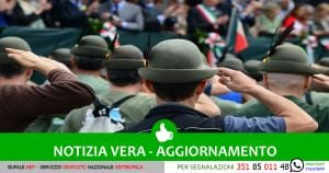 Formations of Alpini mountain soliders salute during pass and review for the 2014 Alpini parade, May 11, 2014, in downtown Pordenone, Italy. The Alpini are widely recognized throughout Italy by their unique green hats accompanied by a single black, white or brown feather distinguishing varying degrees of rank. (U.S. Air Force photo/Airman 1st Class Ryan Conroy)