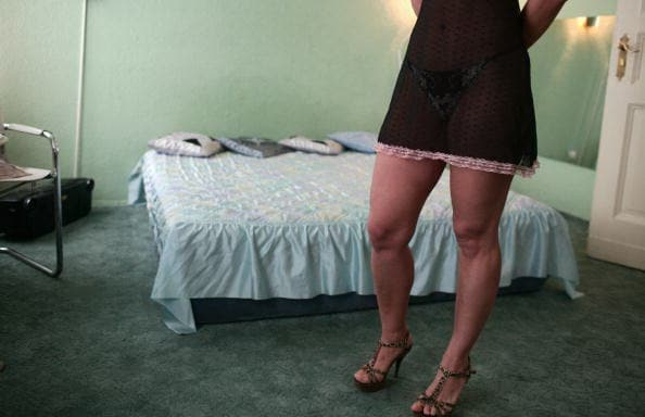 A Ukrainian prostitute stands in front o