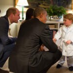 baby george riceve barack obama e michelle