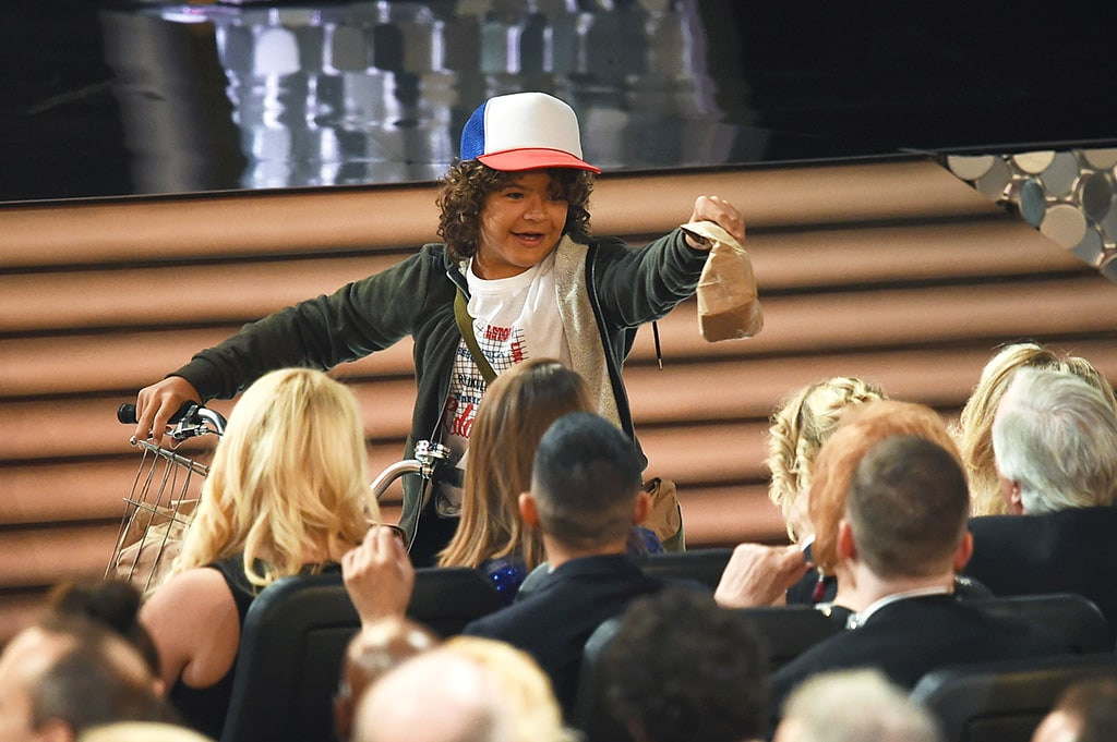 Gaten Matarazzo passes out peanut butter and jelly sandwiches to the audience during the 68th Annual Primetime Emmy Awards at Microsoft Theater on September 18, 2016 in Los Angeles, California.  (Photo by Kevin Winter/Getty Images)
