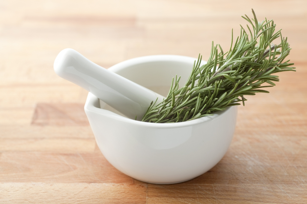 Bunch of rosemary in a pestle.