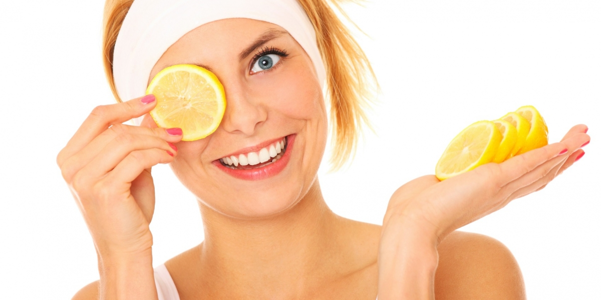 A portrait of a young beautiful woman with lemon over white background