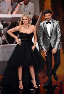 Swiss-Italian TV showgirl Michelle Hunziker (L) and Italian actor Pierfrancesco Favino (R) on stage during the 68th Sanremo Italian Song Festival at the Ariston theatre in Sanremo, Italy, 09 February 2018. The 68th edition of the television song contest runs from 06 to 10 February. ANSA/ETTORE FERRARI