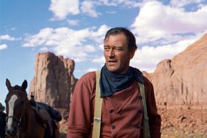 In this photo released by Warner Bros., actor John Wayne plays Ethan Edwards in the newly remastered and restored special edition DVD of ?The Searchers.? Director John Ford and frequent leading man Wayne forged one of Hollywood's most enduring partnerships. Ford and Wayne rode again at the 59th International film festival in Cannes, which featured a documentary about their collaboration. (AP Photo/Warner Bros.)