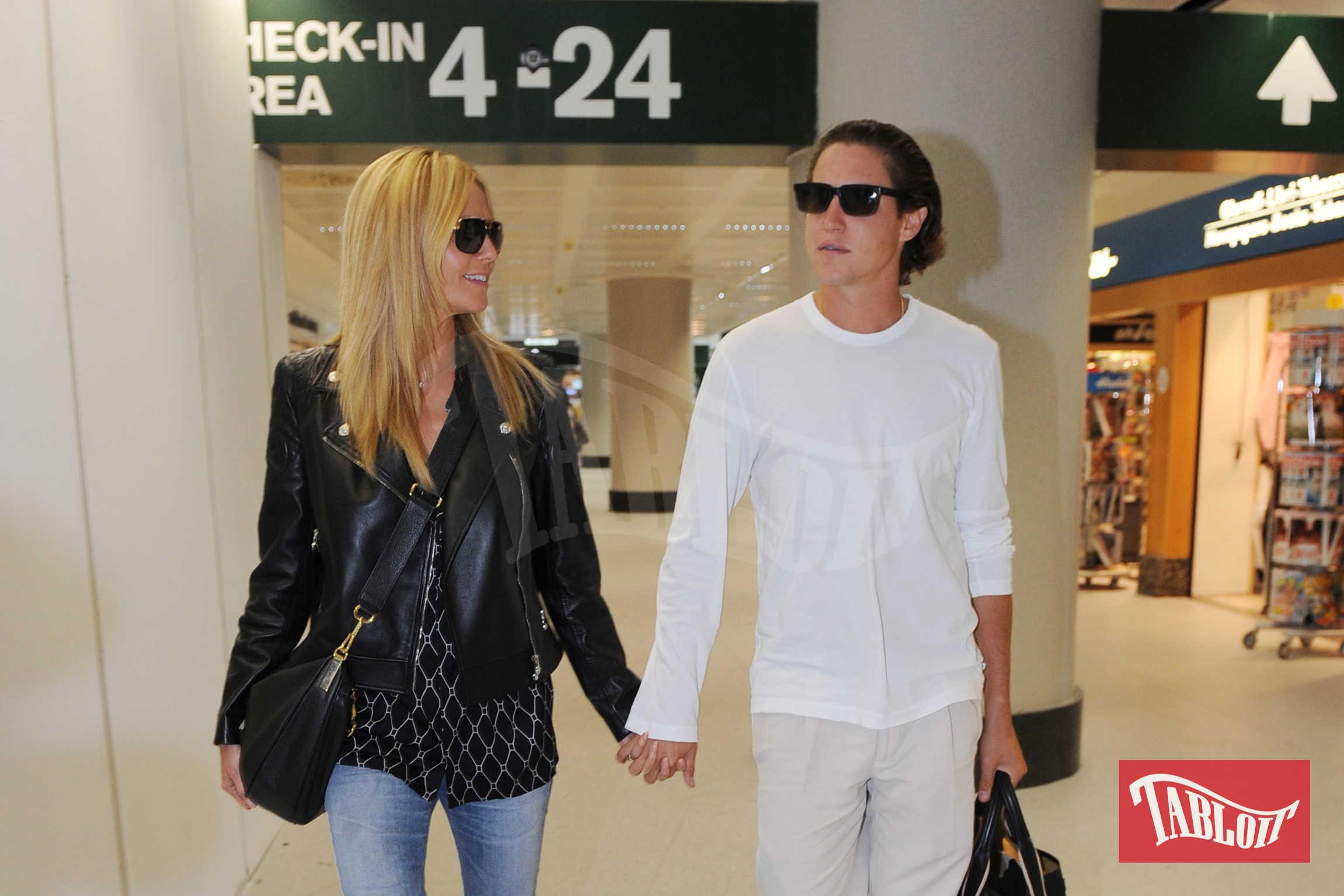 """Heidi Klum e Vito Schnabel all'aeroporto di Malpensa a Milano nel 2015. Negli ultimi giorni i due si sarebbero riavvicinati: lui ha ricominciato a seguirla su Instagram e a mettere """"mi piace"""" alle sue foto"""